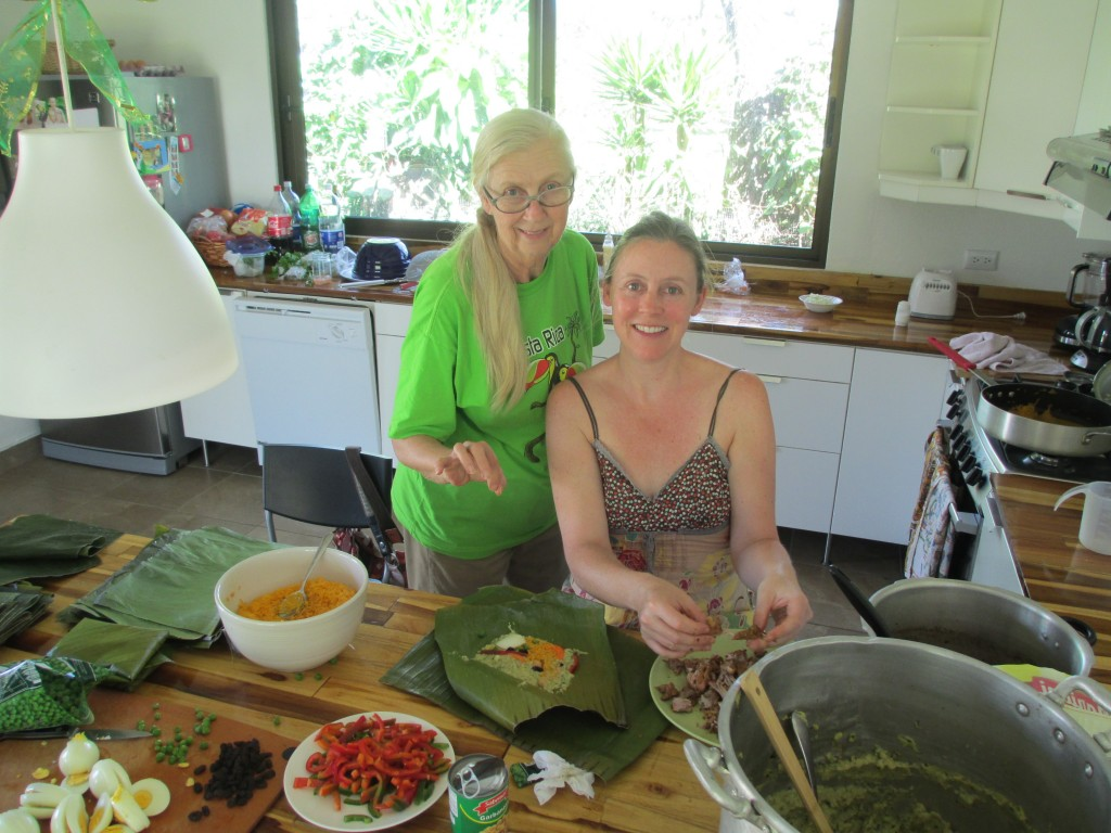 Here is my mother, Sandy, and I hard at it making Christmas tamales. We had to wash all the banana leaves off before we started. We never cooked with banana leaves before, so that was new and fun. It was my mom's idea to streamline our operations to be more efficient. She's good like that.